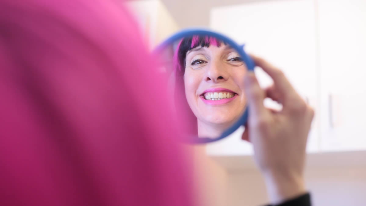 cosmetic consultation - girl looking at happy smile